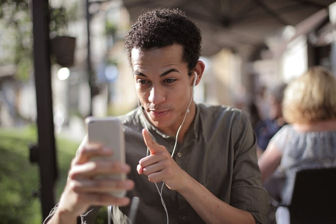 content black man using smartphone for video call on street 3799180